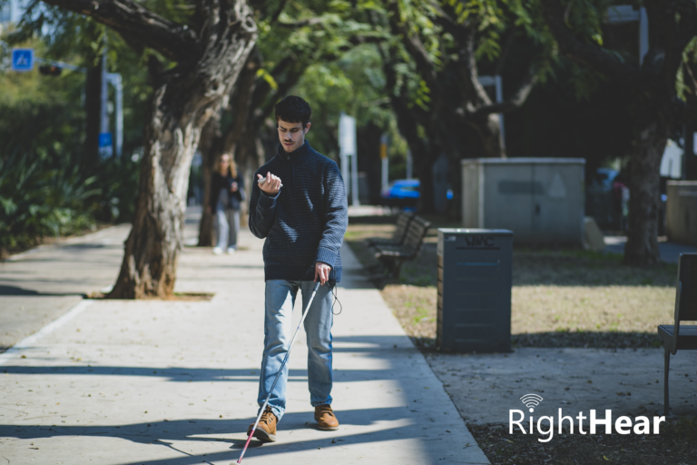 A blind person walking in the street with RightHear