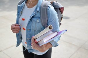 A student holds books