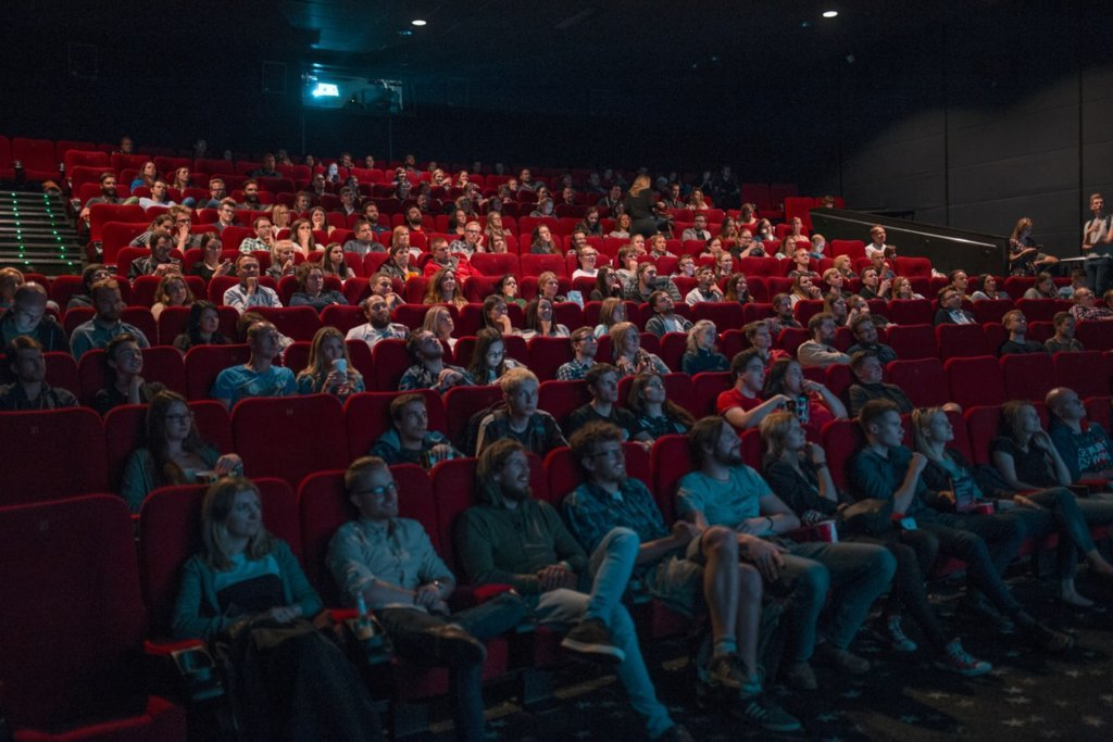 People watching a movie at a cinema